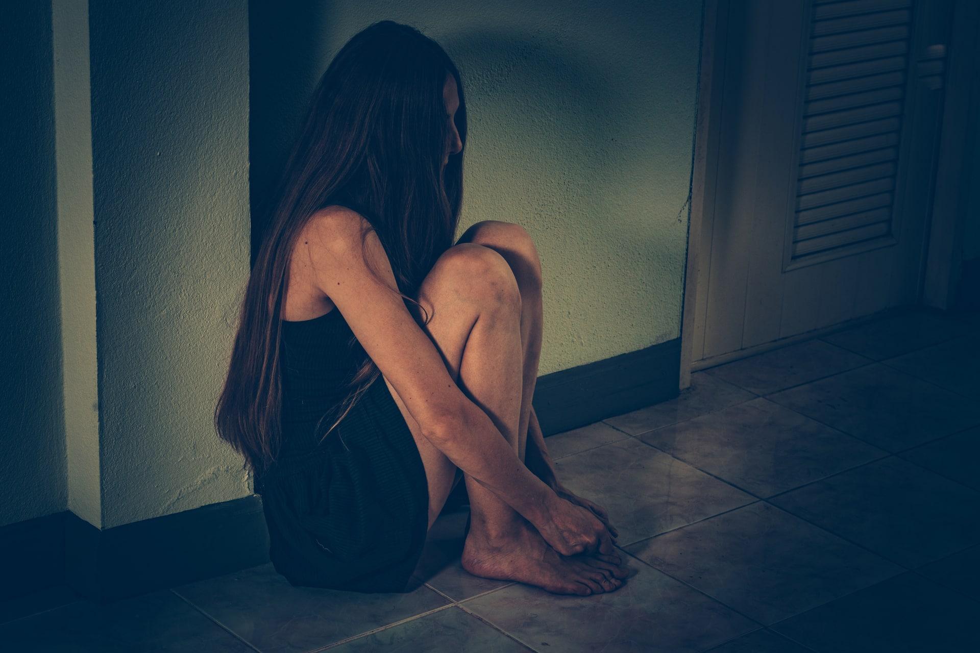 Woman victim. harassment, depression, drug addiction, human trafficking. PTSD post-traumatic stress