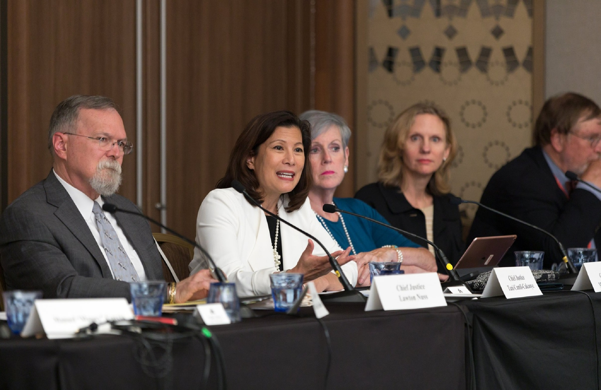 California Supreme Court Chief Justice Tani Cantil-Sakauye (speaking), flanked by Chief Justice Lawton Nuss of the Kansas Supreme Court (left), Chief Justice Maureen O'Connor of the Supreme Court of Ohio and Justice Debra Stephens, Washington Supreme Court
