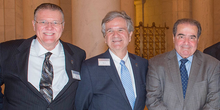 New NJC Board of Trustees Chair Matt Sweeney (center), Trustee Kim Dean Hogrefe (left) and Justice Antonin Scalia attend a reception held by the College at the U.S. Supreme Court in September 2014.