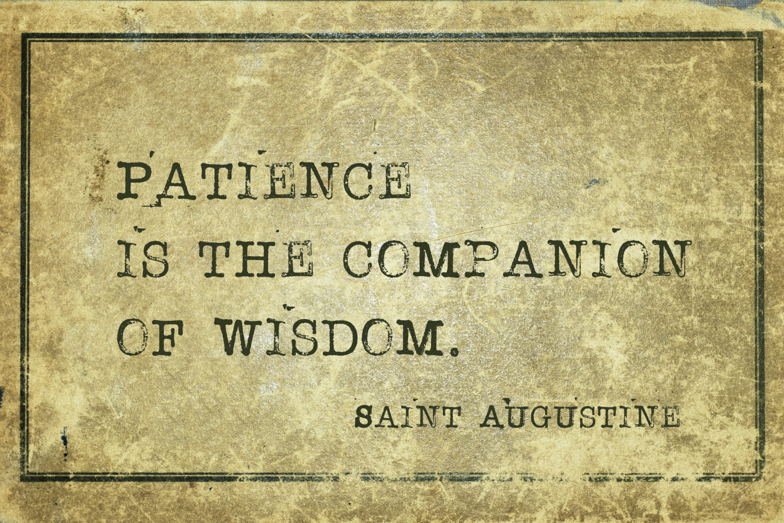 Patience is the companion of wisdom - quote of ancient Christian theologian and philosopher Saint Augustine printed on grunge cardboard